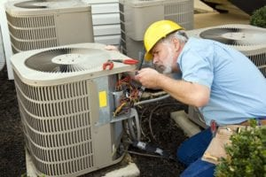 working on air conditioning unit maintenance